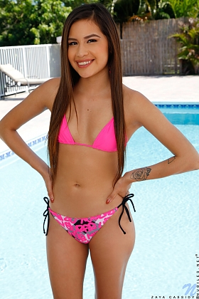 Tight teen Zaya Cassidy is a budding beauty with soft little boobs and a lusty petite body. Once she has peeled off her bikini bra and bottom, it's only a matter of time before she lays herself out beside the pool and goes to town on her landing strip pussy with her magic fingers.